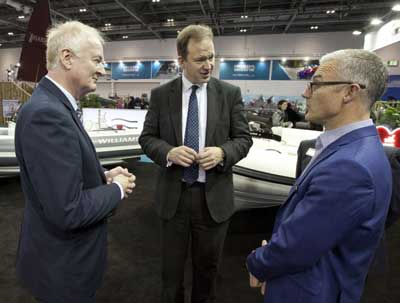 Howard Pridding, BMF, Jesse Norman, MP and Mat Hornsby, Director, Williams Jet Tenders at the London Boat Show 2017, Excel, London. Copyright OnEdition